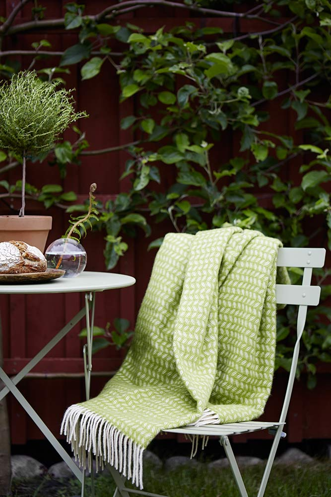 Chair-with-Leaf-throw-in-green